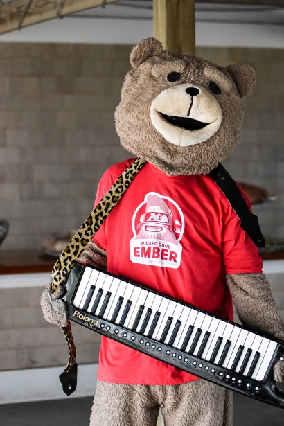 Bear mascot with Ember.js t-shirt and keytair posing during party