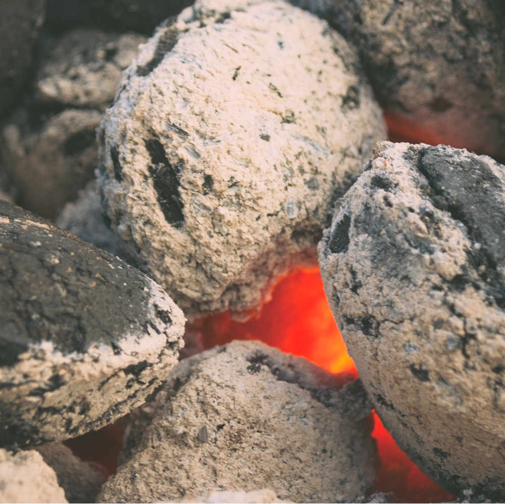Burning ember under stones