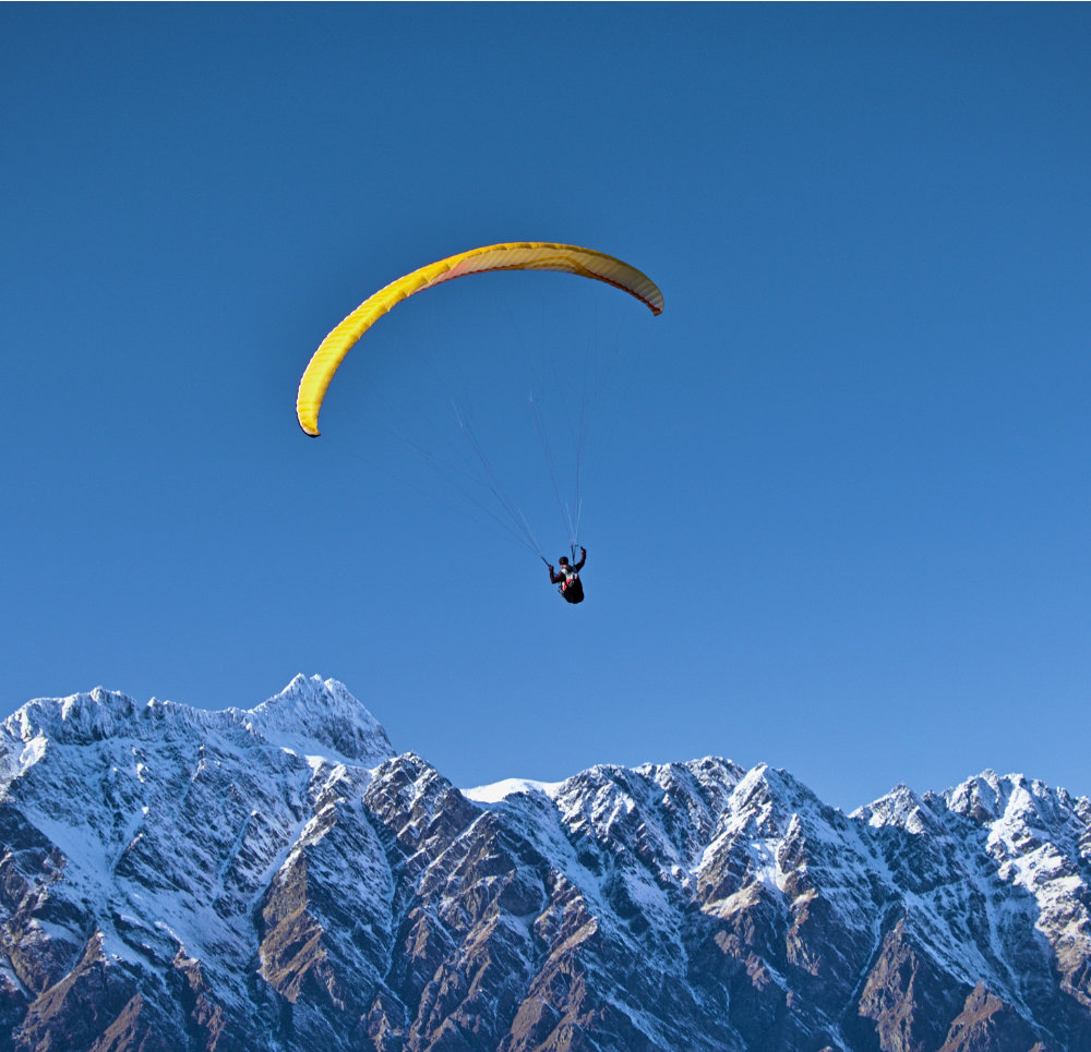 Person hanggliding over mountains