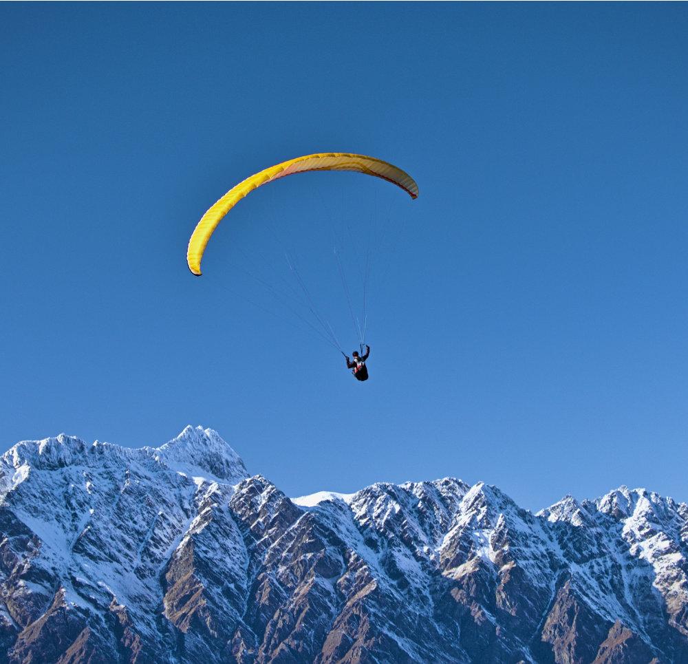 Person hanggliding over mountains
