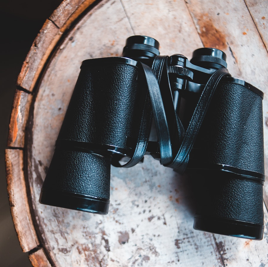 Binoculars on wood table