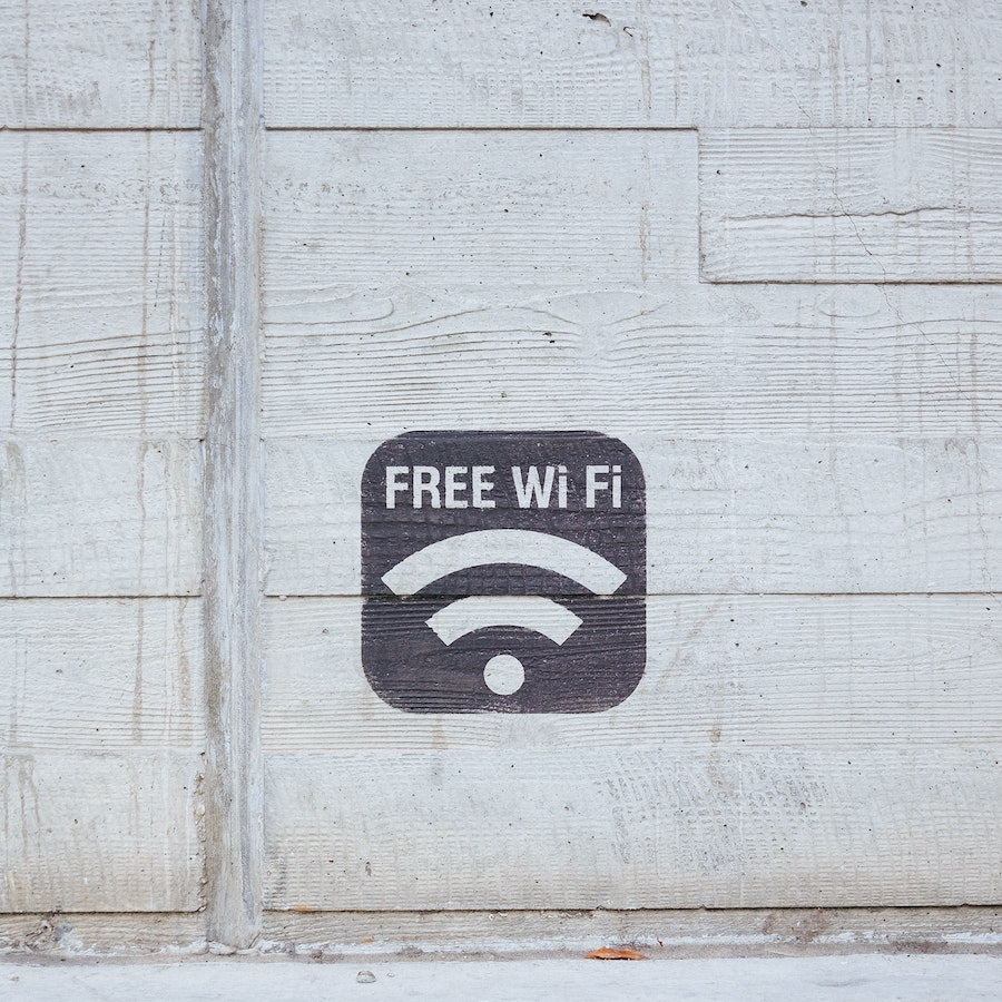 Free Wifi Sign Painted on White Wall